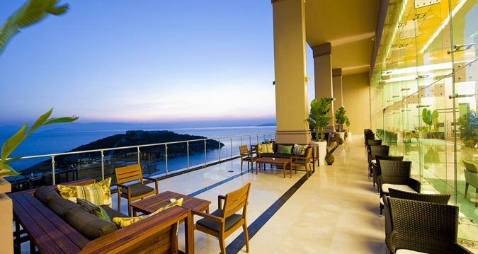 Lobby Bar Terrace: Unwind with a cocktail on the terrace admiring the sunset over the Aegean Sea.