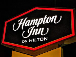Hampton Inn by Hilton sign logo
