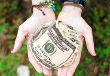 Money give hand dollars